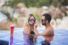 Young happy lovers on romantic travel honeymoon having fun on vacation summer holidays romance. Stock Photos