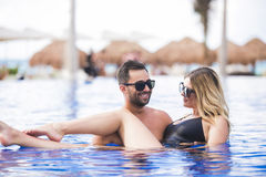 Young happy lovers on romantic travel honeymoon having fun on vacation summer holidays romance. Royalty Free Stock Photo
