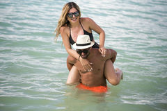 Young happy lovers on romantic travel honeymoon having fun on vacation summer holidays romance. Royalty Free Stock Images