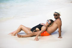 Young happy lovers on romantic travel honeymoon having fun on vacation summer holidays romance. Stock Image