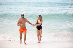 Young happy lovers on romantic travel honeymoon having fun on vacation summer holidays romance. Royalty Free Stock Image
