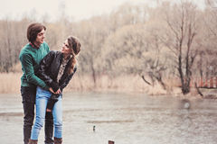 Young happy loving couple having fun on the walk in early spring Royalty Free Stock Images