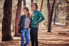 Young happy loving couple on the walk in sunny forest Royalty Free Stock Photography