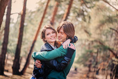 Young happy loving couple on the walk in sunny forest Royalty Free Stock Photo