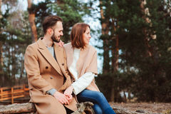 Young happy loving couple walking outdoor in autumn Stock Photos