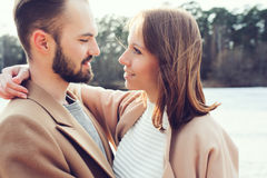 Young happy loving couple walking outdoor in autumn Royalty Free Stock Image