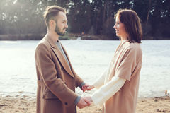 Young happy loving couple walking outdoor in autumn Royalty Free Stock Images