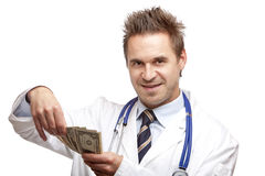 Young happy male doctor counting money Stock Photography
