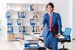 The young happy male employee in the office. Young happy male employee in the office stock images