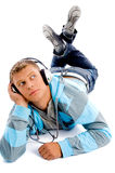Young happy male with headphones and thumbs up Royalty Free Stock Image