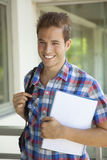 Young happy male student smiling. Outdoors Stock Photos