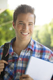 Young happy male student smiling. Outdoors Royalty Free Stock Photo