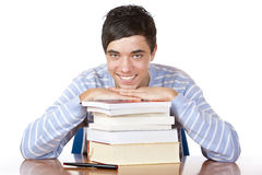 Young happy male student with study books Royalty Free Stock Photos