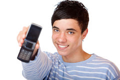 Young happy male teenager shows mobile phone Stock Photos