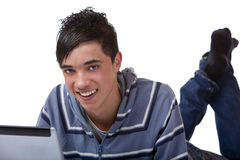Young happy male teenager working on laptop Royalty Free Stock Photos