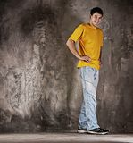 Young happy man. Against grunge wall stock image