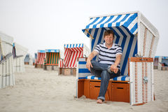 Young happy man on the beach of St.Peter Ording, North Sea, Stock Photo