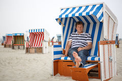Young happy man on the beach of St.Peter Ording, North Sea, Royalty Free Stock Images