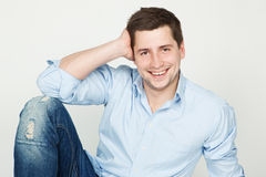 Young happy man in blue jeans and shirt Stock Image