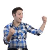 Young happy man in blue shirt cheering Stock Image
