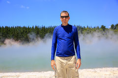 Young happy man in blue shirt.  Wai-O-Tapu thermal area, NZ Stock Photos