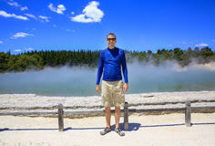 Young happy man in blue shirt.  Wai-O-Tapu thermal area, NZ Stock Photo