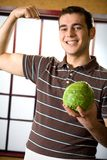 Young happy man with cabbage Royalty Free Stock Photography