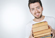 Young happy man carrying books Stock Photo