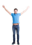 Young happy man in casuals with raised hands up. Royalty Free Stock Photos