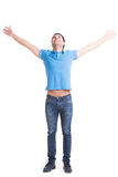 Young happy man in casuals with raised hands up. Young happy man in casuals with raised hands up and looking up -  isolated on white Stock Image