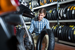 Young happy man customer holding his motorcycle Royalty Free Stock Photos