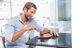 Young happy man eating his cake Stock Photography