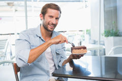Young happy man eating his cake Royalty Free Stock Photography