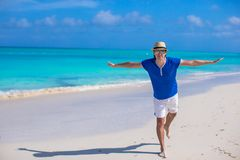 Young happy man enjoying summer vacation on Royalty Free Stock Images