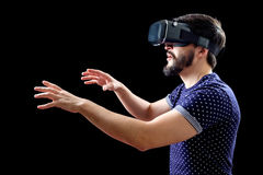 Young happy man experiencing virtual reality Stock Photo