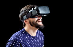 Young happy man experiencing virtual reality Stock Images