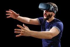 Young happy man experiencing virtual reality Stock Photos