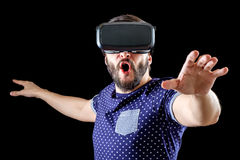 Young happy man experiencing virtual reality Royalty Free Stock Images