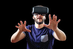 Young happy man experiencing virtual reality Royalty Free Stock Photo