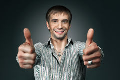 Young happy man going thumbs up Stock Photos