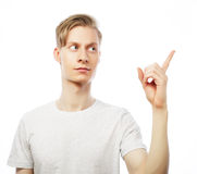 Young happy man with good idea sign in casuals looking at camera Stock Photography