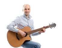 Young happy man with guitar Stock Images