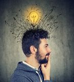 Young happy man has a bright idea. E profile of a young happy man has a bright idea Royalty Free Stock Image