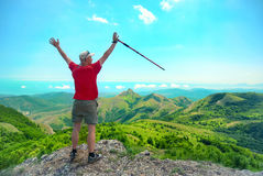 Young happy man with hiking stick Stock Images