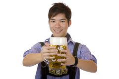 Young happy man hold Oktoberfest beer stein (Mass) Royalty Free Stock Images