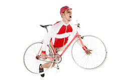 Young happy man holding his bike posing as playing Stock Photos