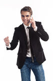 Young happy man holding mobile phone. Portrait of handsome young business man using cell phone, smiling Stock Images