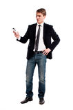 Young happy man holding mobile phone Stock Images