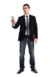 Young happy man holding mobile phone. Portrait of handsome young business man using cell phone, smiling Stock Image