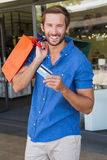 Young happy man holding shopping bags and a credit card Stock Images